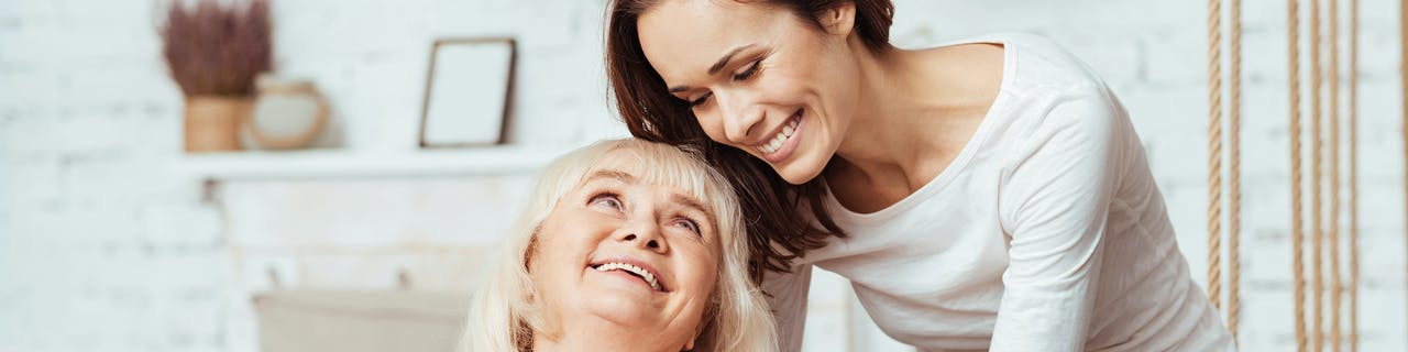 A client looking up at her carer with admiration