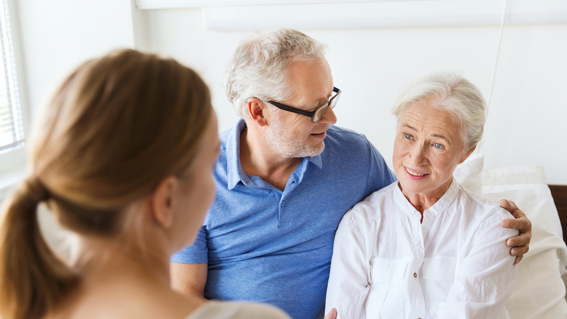 Carer with an elderly couple providing live-in care support
