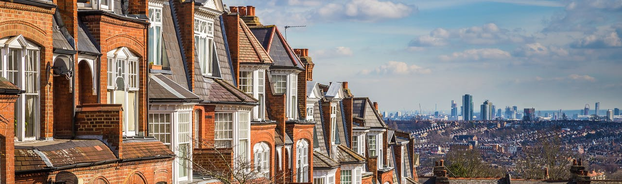 London, England - Typical brick houses and flats and panoramic view of london on a nice summer morning with blue sky and clouds taken from Muswell Hill