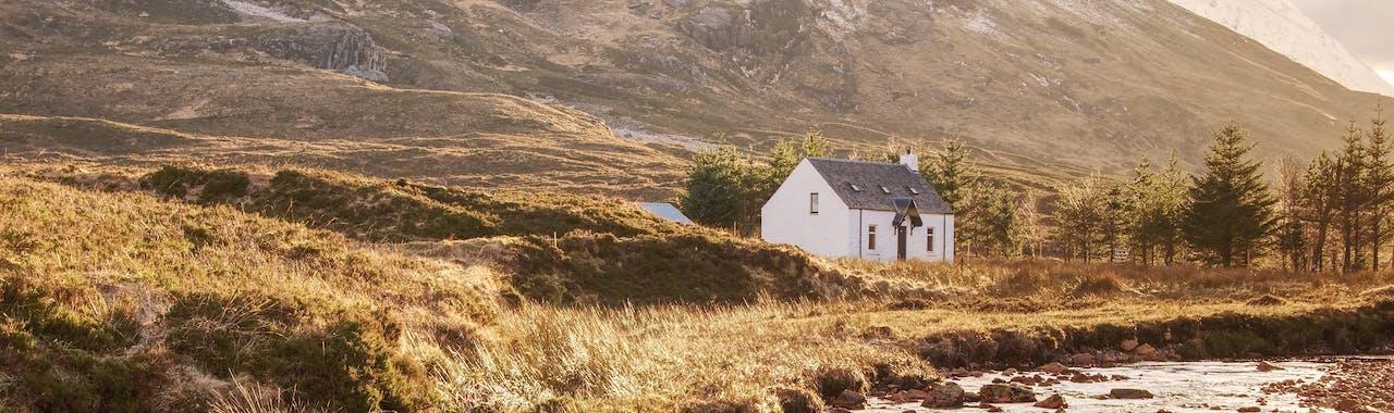 Scottish Highlands, The mountain cottage nestled below Buachaille Etive Mor